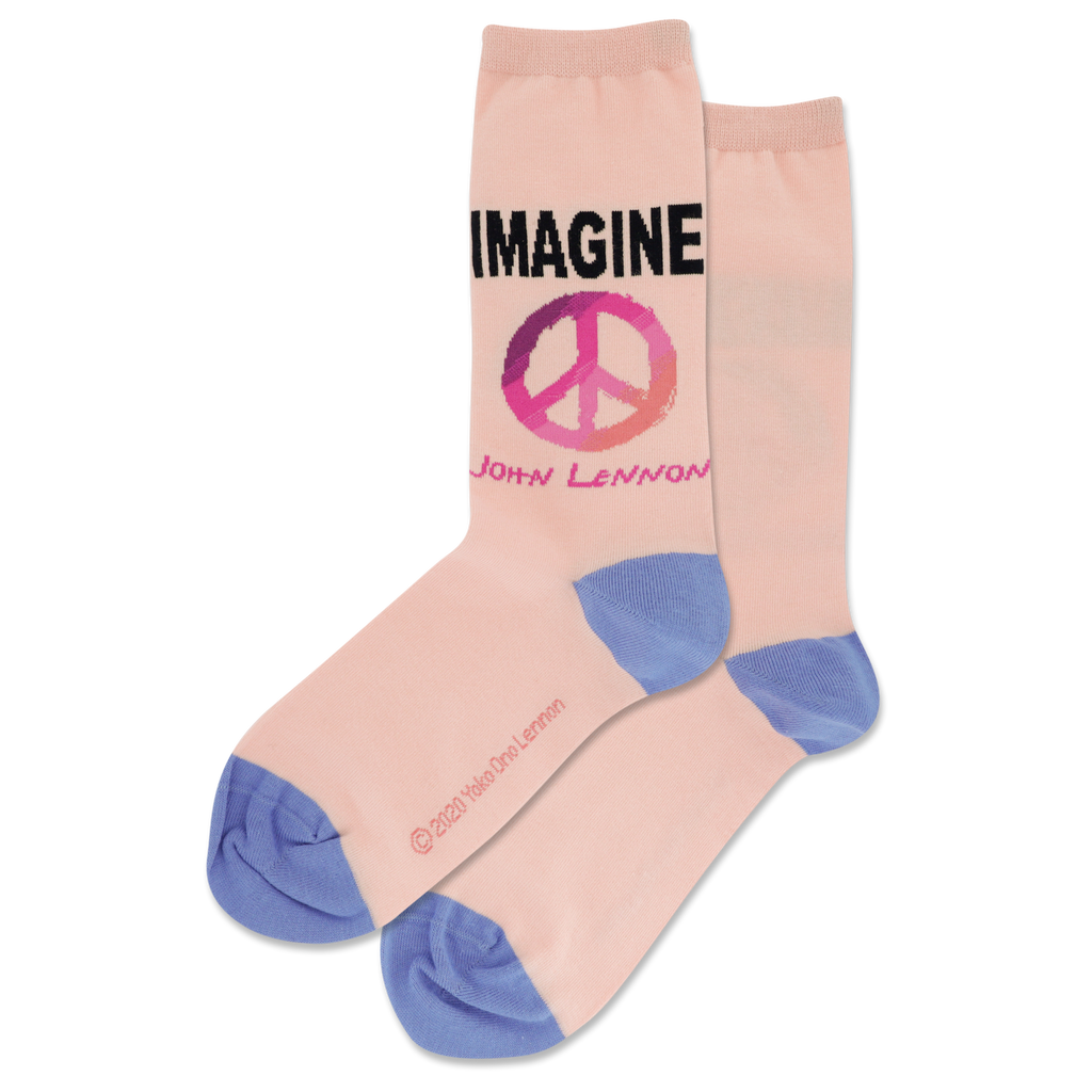 Hotsox John Lennon Imagine crew socks. Imagine in caps set above a peace sign, with John Lennon's name under the graphic, over soft pink background.