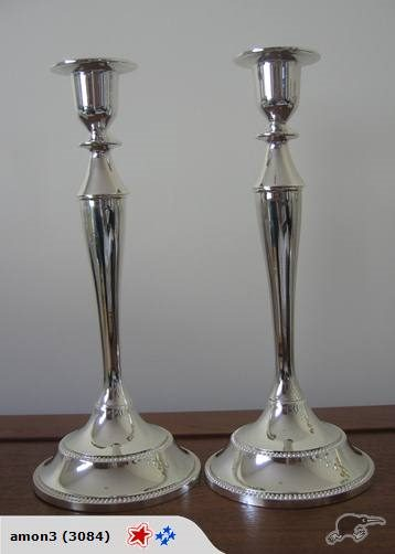 A SET OF TWO SINGLE SILVER CANDLE HOLDERS