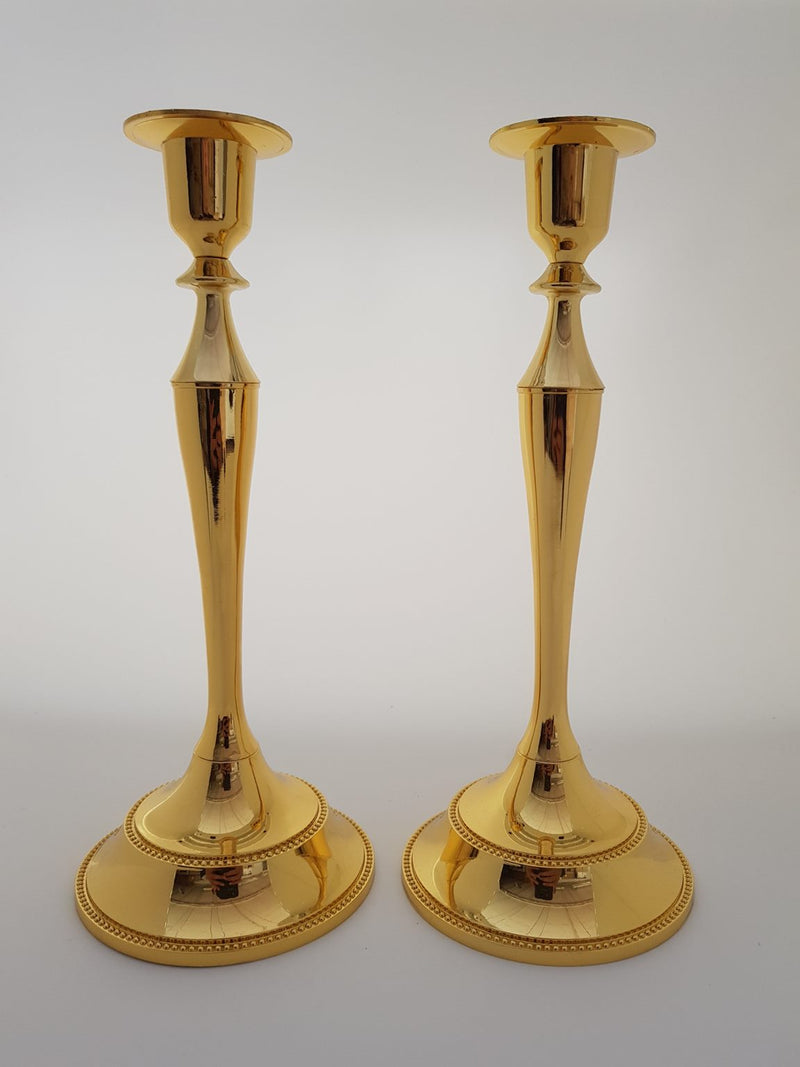 A SET OF TWO SINGLE GOLDEN CANDLE HOLDERS
