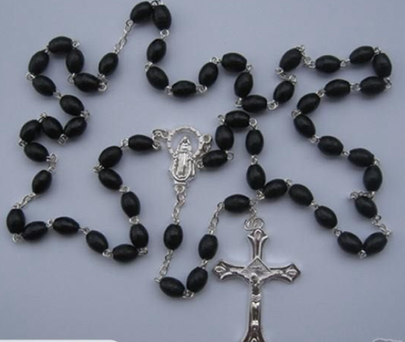 Wooden black rosary with oval shaped beads