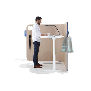 man standing at home office furniture krossi desk sit to stand