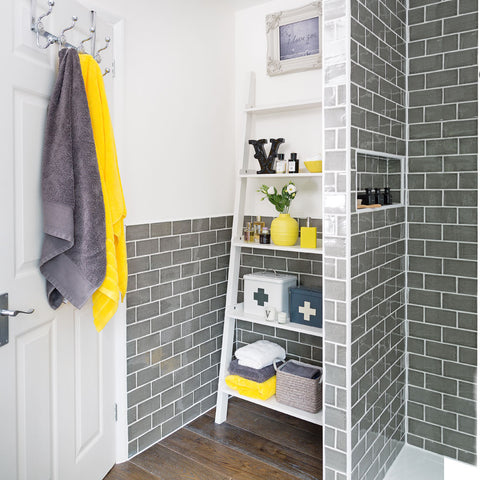 Bathroom With Yellow & Grey Towels