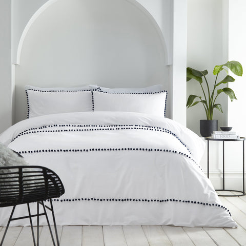 Bedroom With Bedding & White Bedding