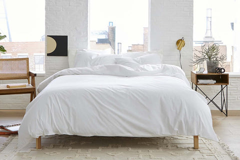 White Cotton Sheets in a Bedroom Setting