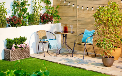 Rattan Table & Chairs Set + Solar String Lights On Fence