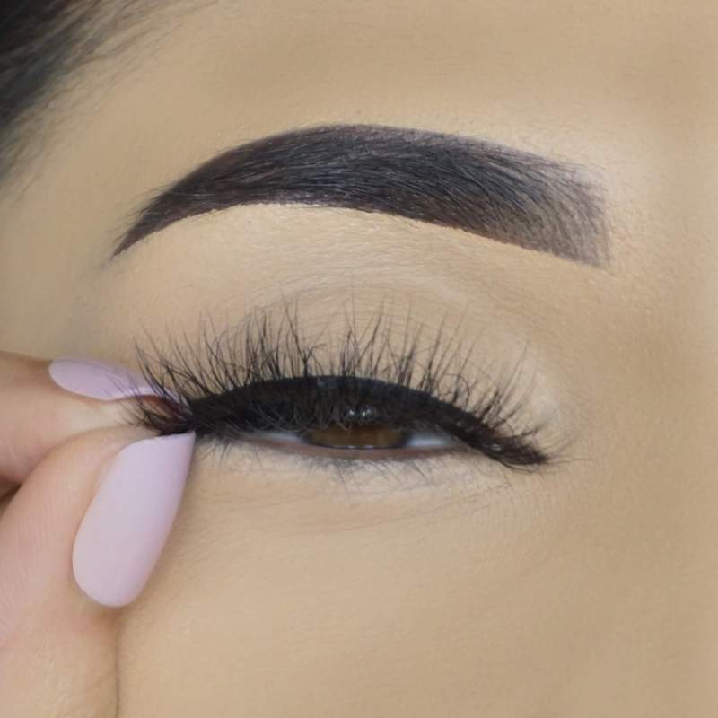 Apply your favorite lash directly on top of the extra-tacky eyeliner.  Re-apply eyeliner on the inner eye corner for maximum lash hold and to prevent lifting.