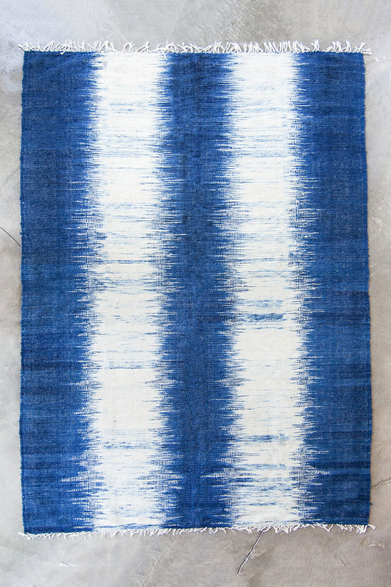 Full size indigo rug showing tassels