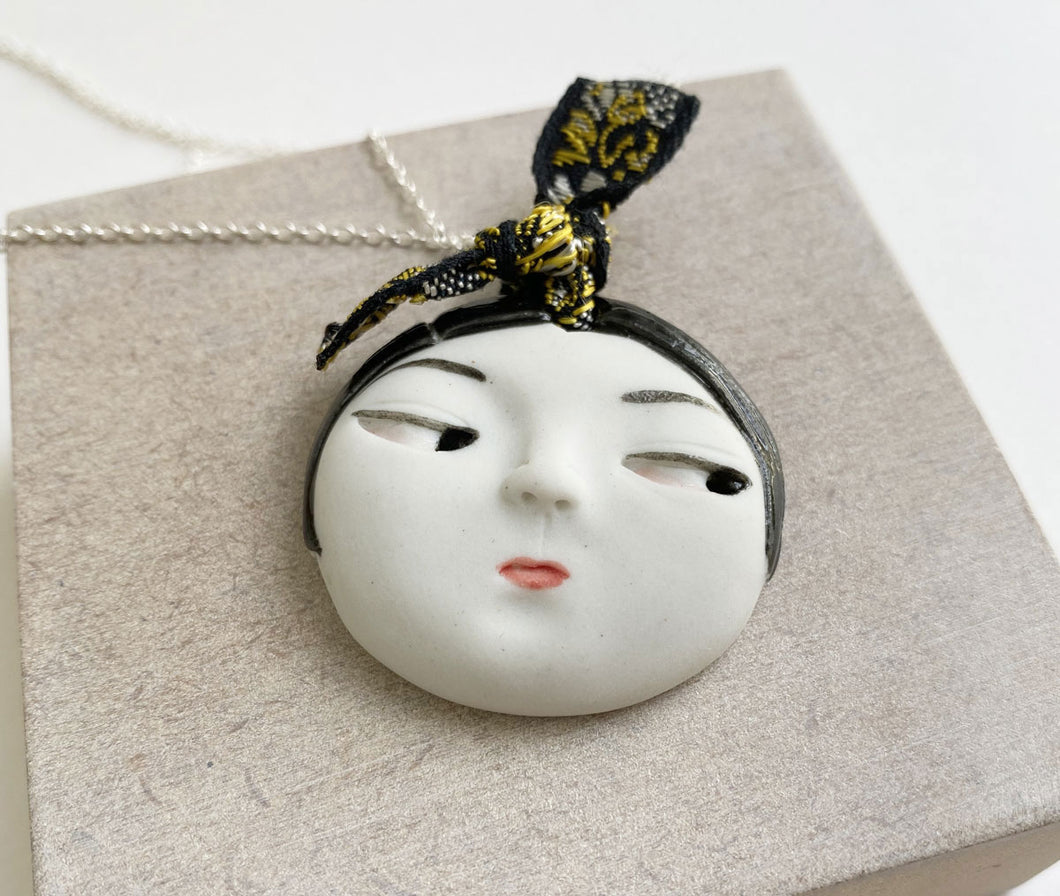 'Face' porcelain pendant by Dai Li