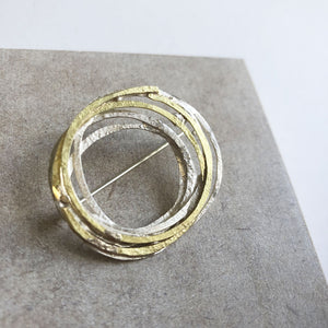'Wrap' brooch in gold and silver by Shimara Carlow