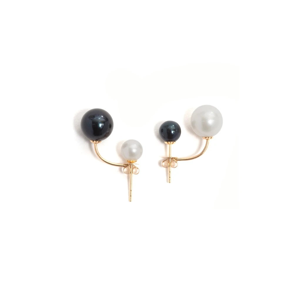 'Suspended pearl' stud earrings by Melanie Katsalidis