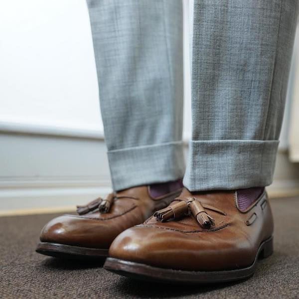 Brown loafers with grey trousers
