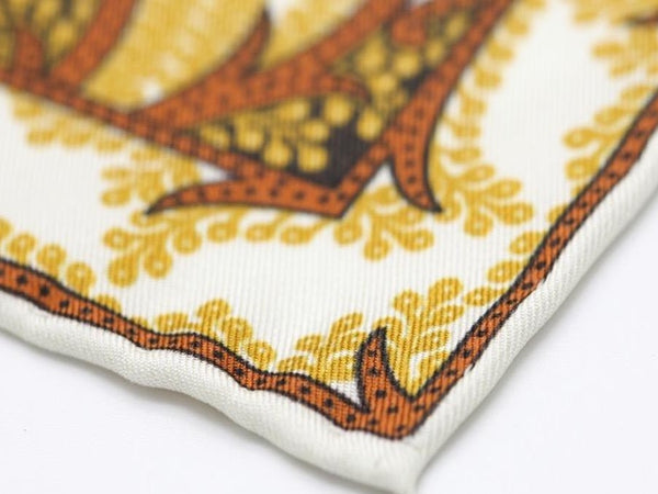 white and gold paisley pocket square
