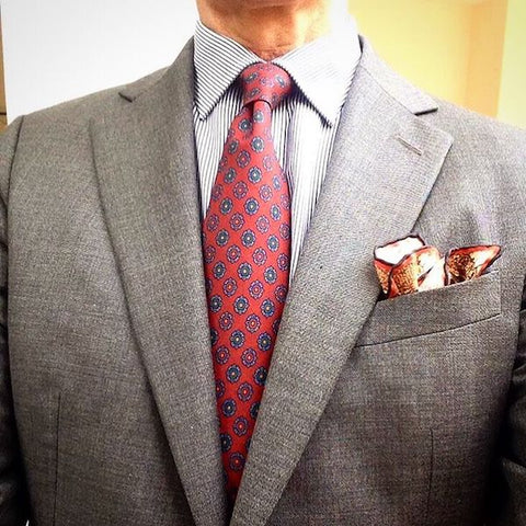 Grey jacket with red tie and pocket square