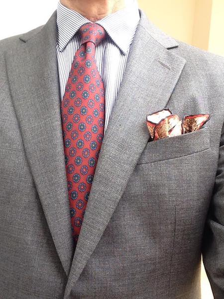 Grey jacket red tie pocket square