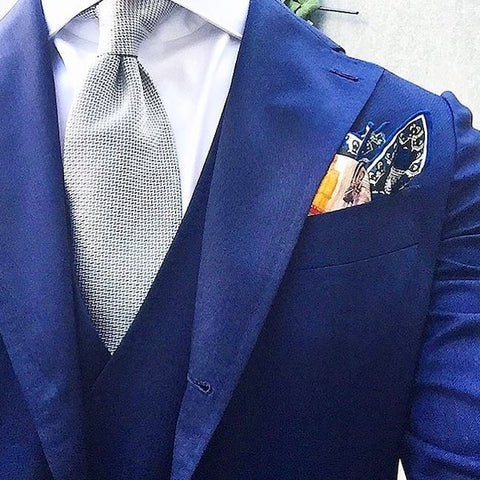 Grey tie with blue pocket square