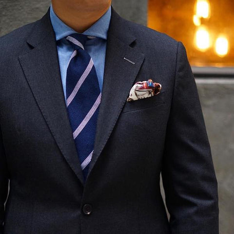 Navy blue striped tie and pocket square