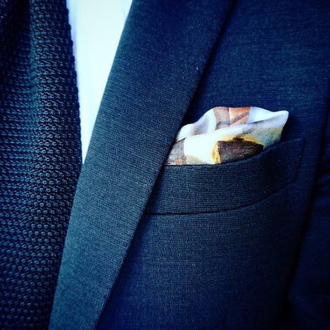 Navy jacket with pocket square
