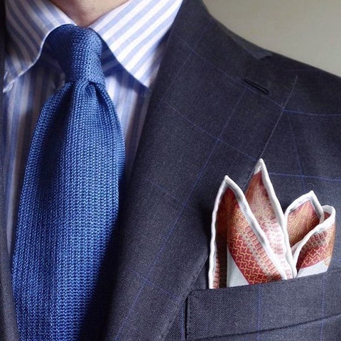 Pinstripe suit and pocket square