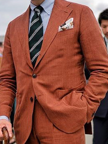 Suit and navy striped tie