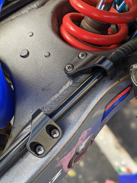 Flexible Rear Brake Line Guides