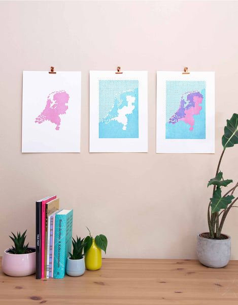 Triptych of two layers of Letterpress art print showing map of the Netherlands and the area below sea level. Magenta plus cyan plus final print. White background.