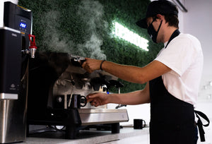 An image of our barista crafting a a special beverage just for coffee loving members.