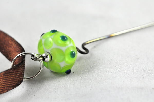 Spinner's Fetch Hook (Orifice hook) with Green/White Lampwork Bead