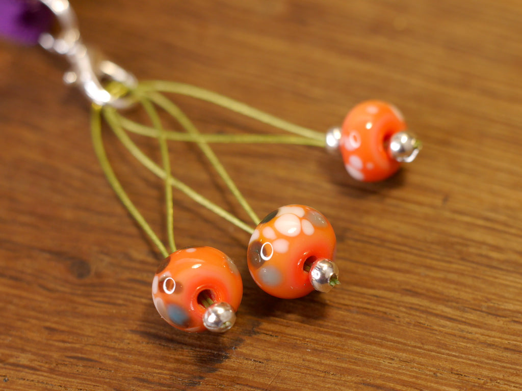 Knitters' Lampwork Stitch Marker Set - Orange with Brown and Blue Speckles