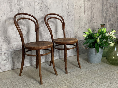 A Pair of Thonet Style Round Back Embossed Bentwood Bistro Chairs