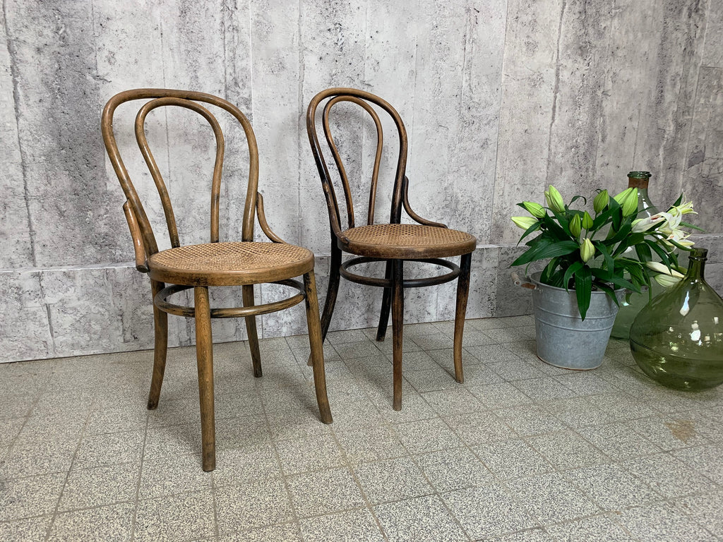 Two Thonet Style Round Back Embossed Bentwood Bistro Chairs with Cane Seat Pads