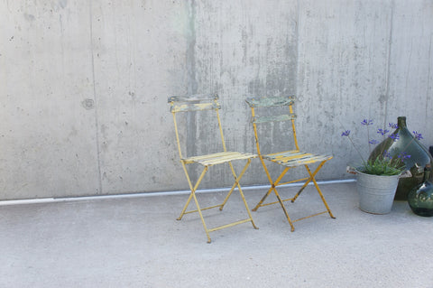 Two Yellow Painted Folding Bistro Chairs