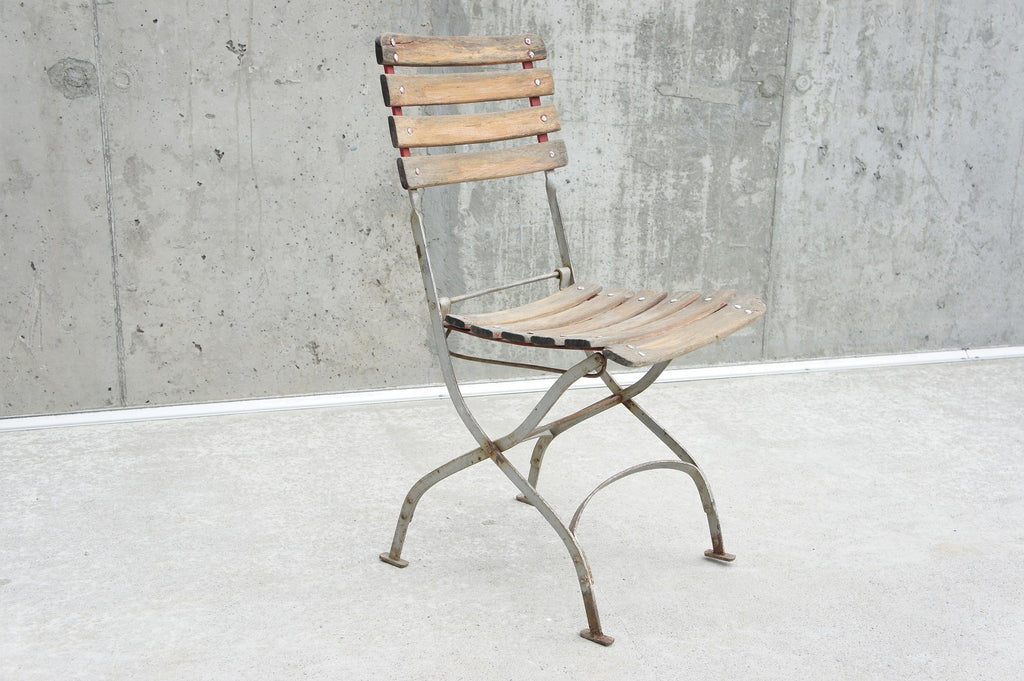 Single Faded Red Folding Chair