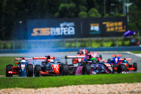 Formula Renault cars compete for position on the track
