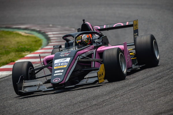 Driver Brendon Leitch on the track in the cockpit of the pink Oloi F3 car