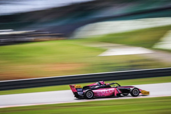 The pink Oloi F3 car on Sepang Circuit in Malaysia