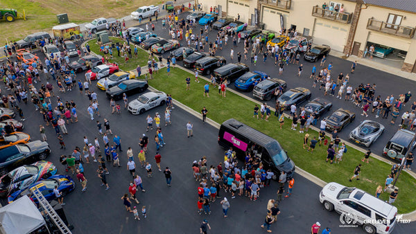 Aerial view of a crowd looking at goldRush Rally cars