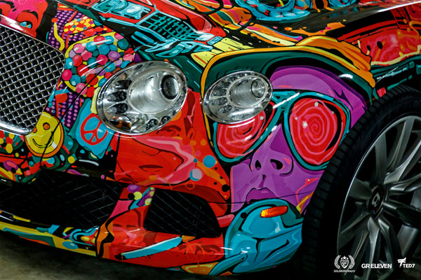 Close up of the headlights of a car with colorful vinyl wrap