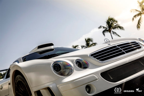 View of the front bumper of a white Mercedes
