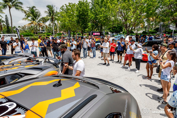 A crowd of onlookers admire goldRush Rally cars