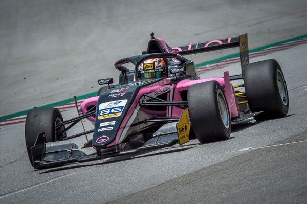 Closeup of the pink Oloi F3 car on the track
