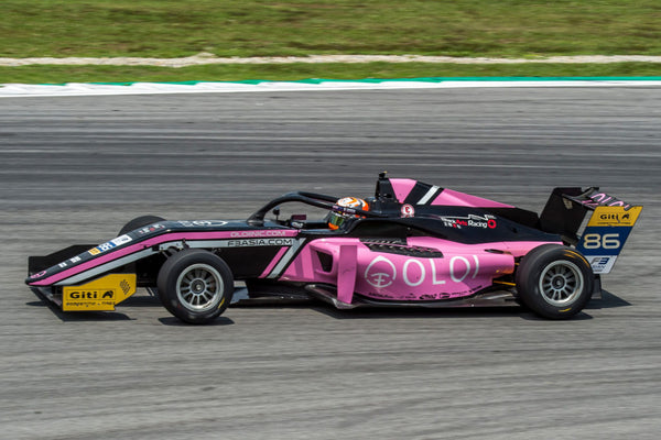Side view of the pink Oloi F3 car