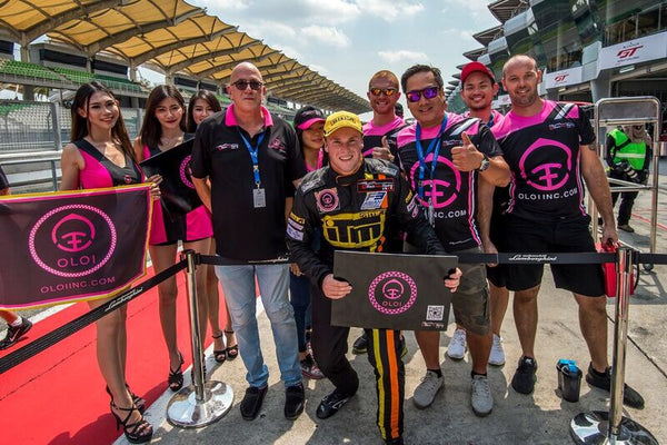Driver Brendon Leitch poses with the Oloi and BlackArts Racing crew