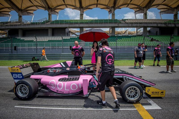 BlackArts Racing crew tend to the pink Oloi F3 car on the starting grid