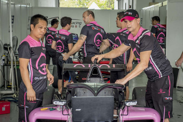 BlackArts Racing crew prepare the pink Oloi F3 car in the garage