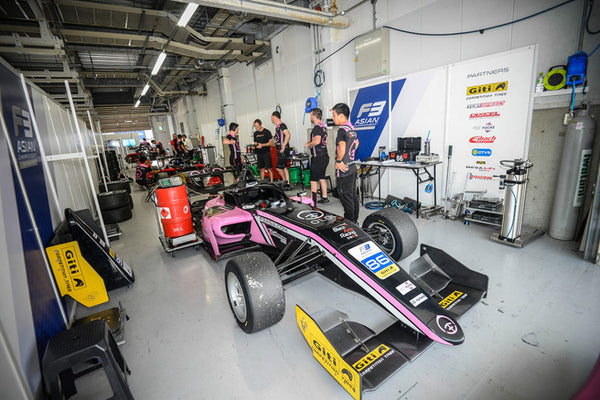 The pink Oloi F3 car in the BlackArts Racing Garage