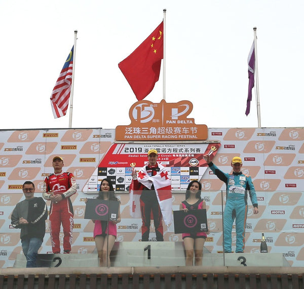 First, second, and third place finishers on the winner's podium