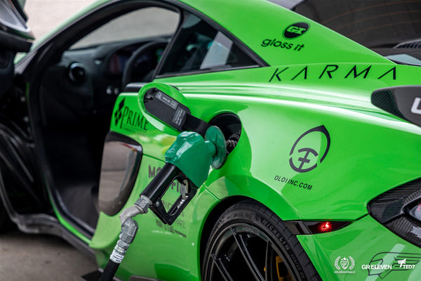 A green car with gas pump featuring the Oloi logo