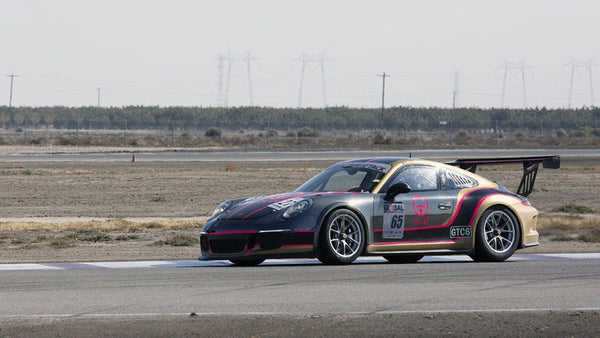 Oloi's Porsche 911 Cup car on the track at Buttonwillow Raceway