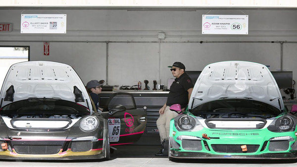 Driver and technician speak in the garage between heats at Global Time Attack 2018