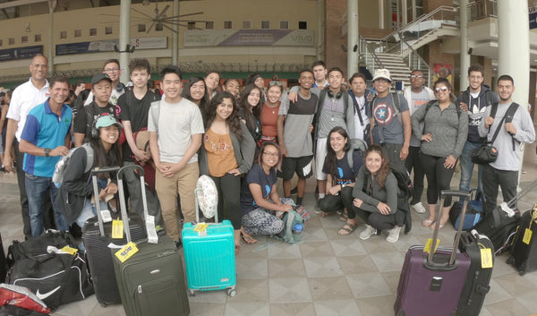 World Without Walls students gather for a group photo with their luggage at the airport
